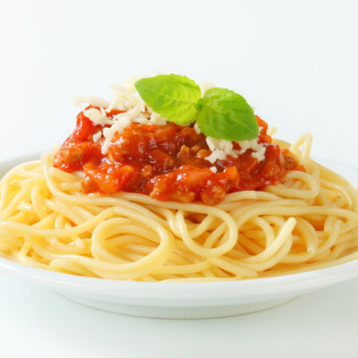 Spaghetti with meat-based tomato sauce and cheese